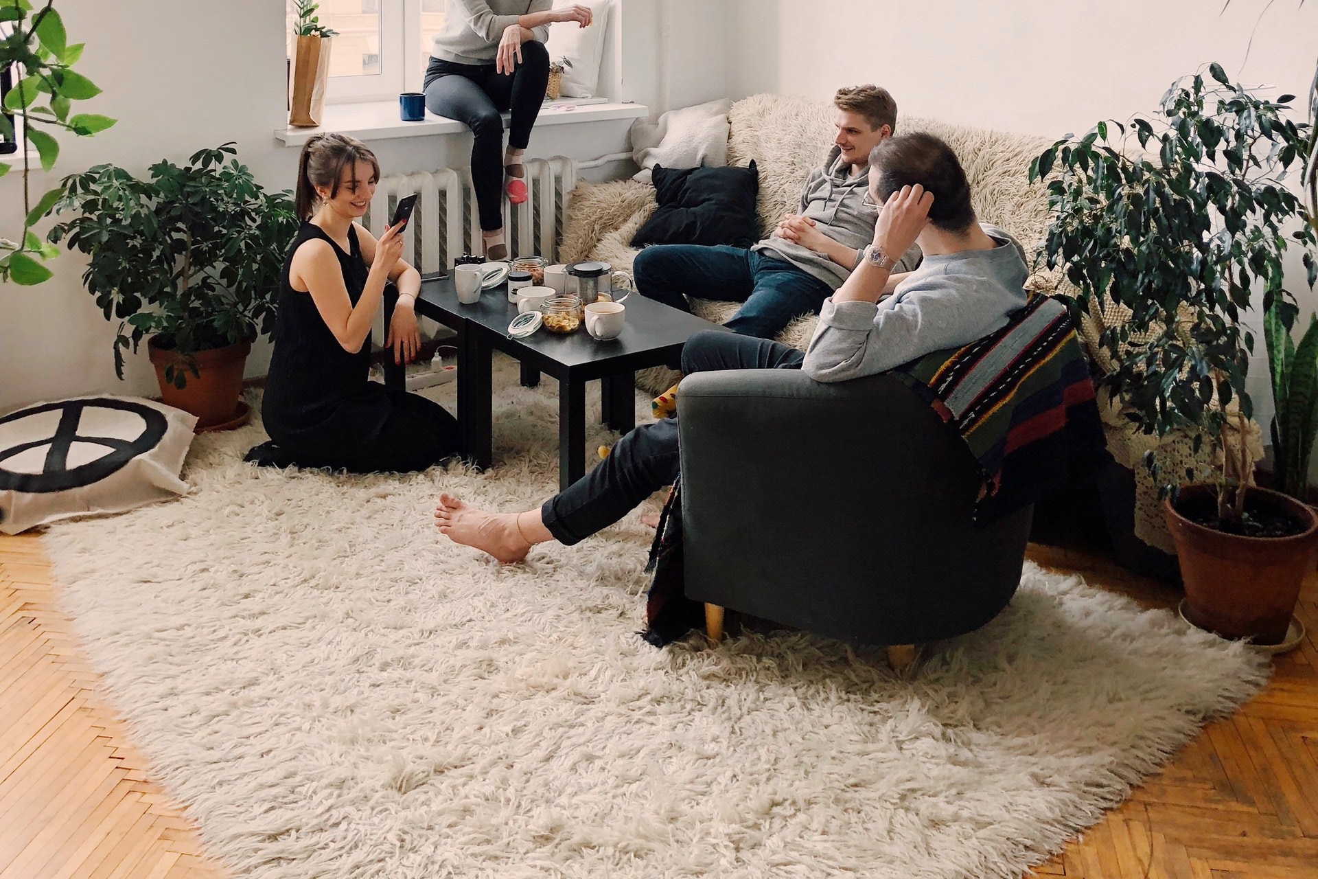 people-gathered-inside-house-sitting-on-sofa-1054974